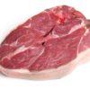 Raw boneless lamb leg steak on white background.