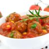 Meat with tomato sauce, herbs and spices, isolated.