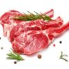 Three pieces of mutton meat with herbs and mixed peppers isolated on white background. Mutton steaks with rosemary.